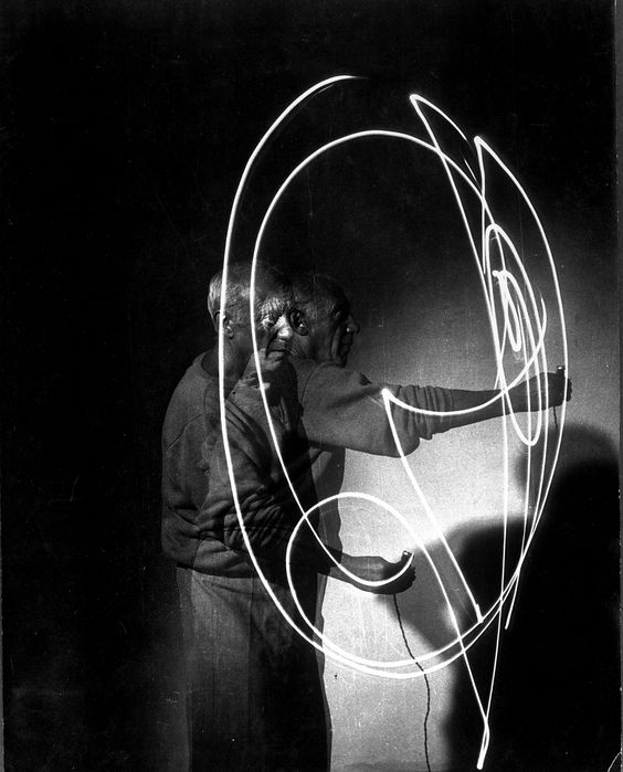 """Gjon Mili—Time & Life Pictures/Getty Images Pablo Picasso """"draws with light,"""" 1949."""