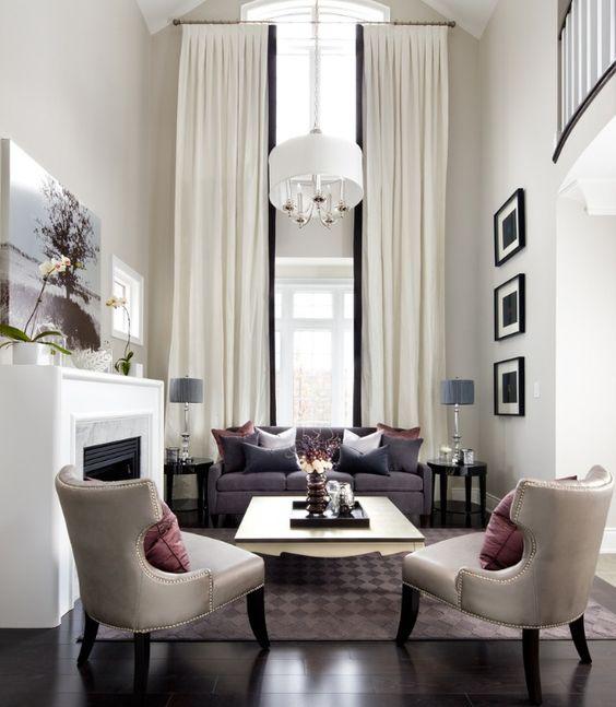 .black sofa with light gray walls