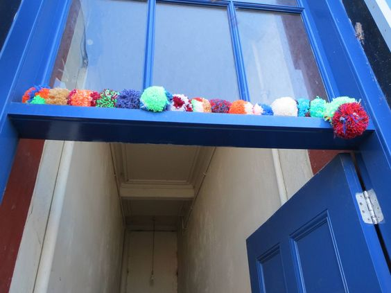 Bernard the pompom caterpillar perching at 11 Albert Place, recipient of funding to restore the traditional close entrance