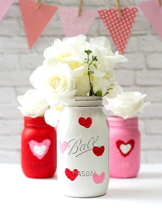 Valentine kid craft idea thumbprint DIY heart mason jar vases for the home. Great house gift ideas for a Galentine's or school Valentine's Day project.
