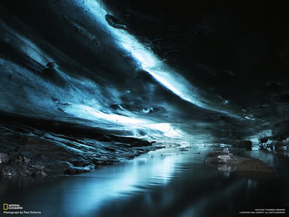 deep underneath a glacier in an ice cave in Skaftafell, Iceland