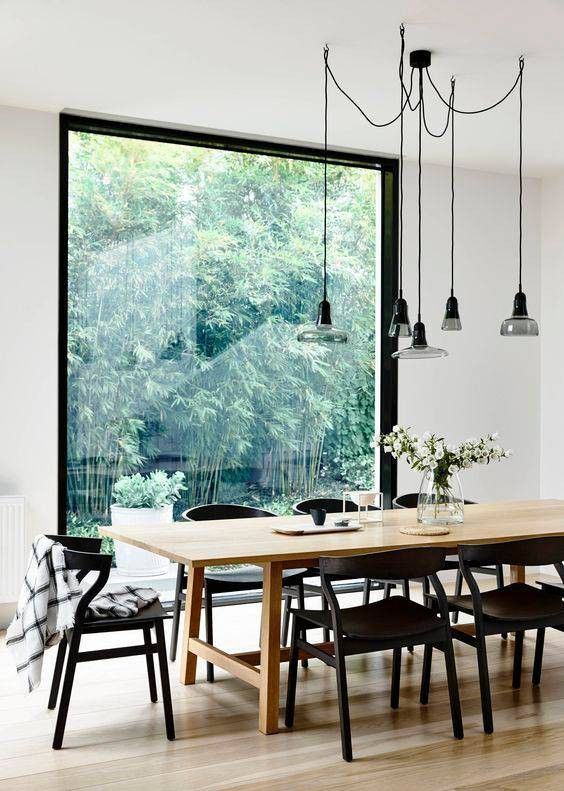 Scandinavian Design Inspired Interiors dining room with big window #blackchairs #diningroom