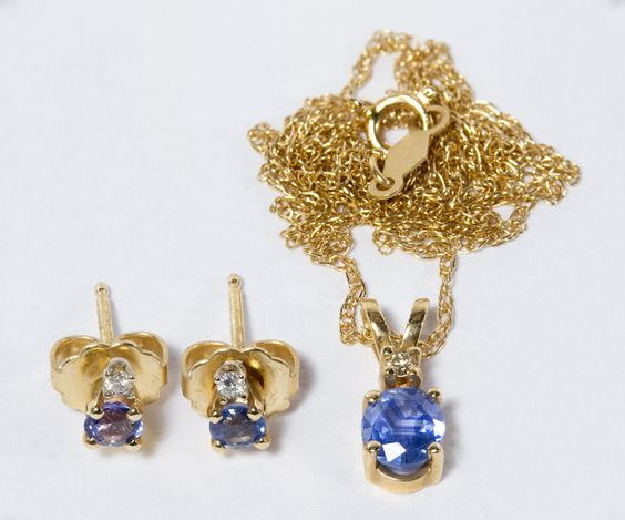 Lot 242: 14k Gold, Blue Topaz and Diamond Jewelry Suite; Including pierced earrings and a necklace with pendant
