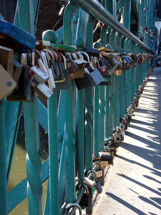 A lot of people in love. Each couple left a padlock to eternize their love. Heavy bridge in Wroclaw, Poland.