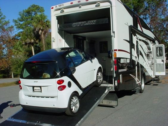 Smart car fits right in this 2010 damon outlaw 3808 class for Class a rv with car garage
