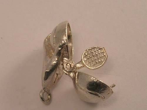 Vintage silver 3D CHIM hand holding tennis ball..opens to reveal a tennis racket (here open)