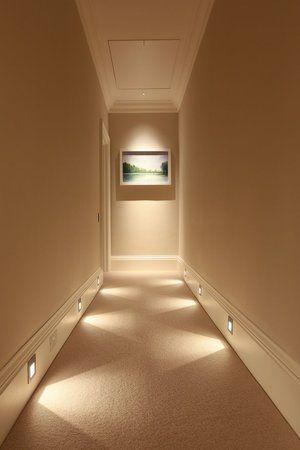 Hallway lit with baseboard lighting