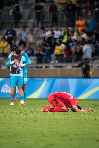 #TOPSHOT Son Heungmin of South Korea reacts after the Rio 2016 Olympic Games quarterfinal men's football match Republic of Korea vs Honduras at the...