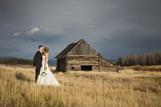 wedding photo with barn/nature scenic background
