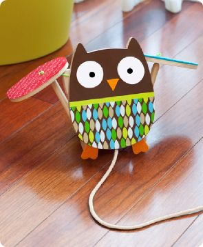 Treetop Friends Flapping Owl Pull Toy  This feathered friend is ready to speed along with your little one!   The brightly colored owl flies across the floor, flapping his wings as your toddler pulls him along.