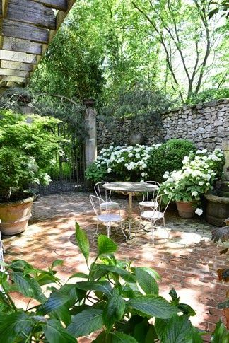 Stone wall home landscape design via christina for Courtyard stone and landscape