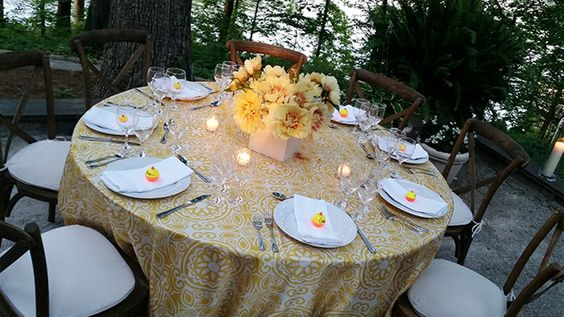 Campbell placed clusters of yellow peonies in the center of each table, and added whimsical name cards made with small fishing buoys.