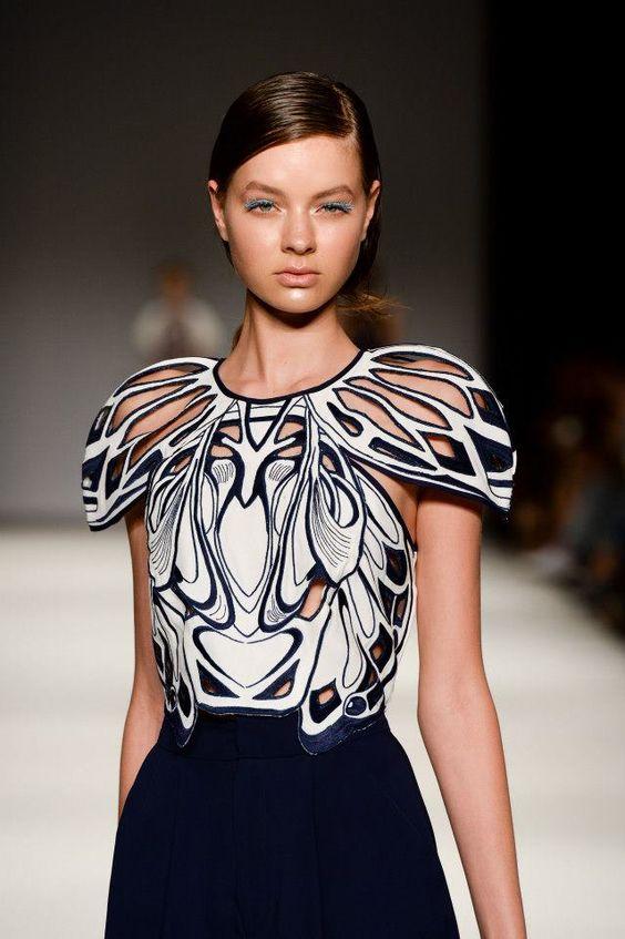 Symmetrical Pattern Fashion - intricate lasercut detail; mirror symmetry; sculptural sleeves // Alice McCall