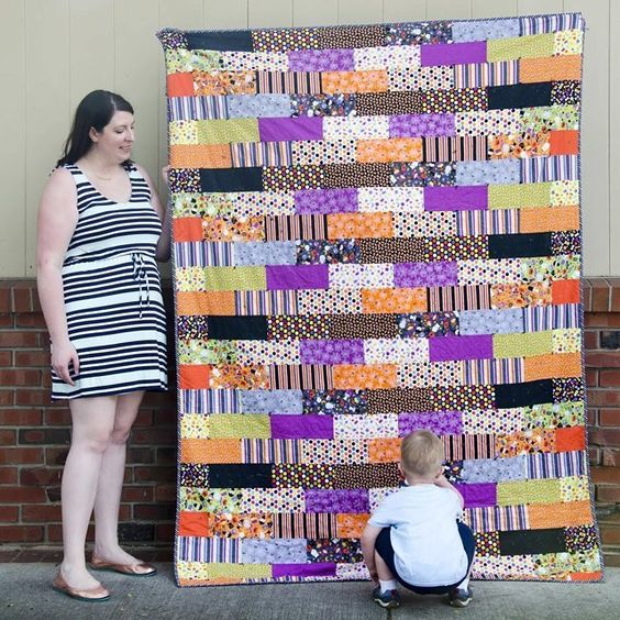 This is my favorite photo from the quilt photo shoot I did this week. My son Luke is just obsessed with the little Halloween characters on it. He thinks everything is a ghost. The ghosts. The pumpkins. The kitties. They are all ghosts.  #quilting #quilt #sewing #patchwork #quilts #sew #sewingproject #lovesewing #patchworkquilt