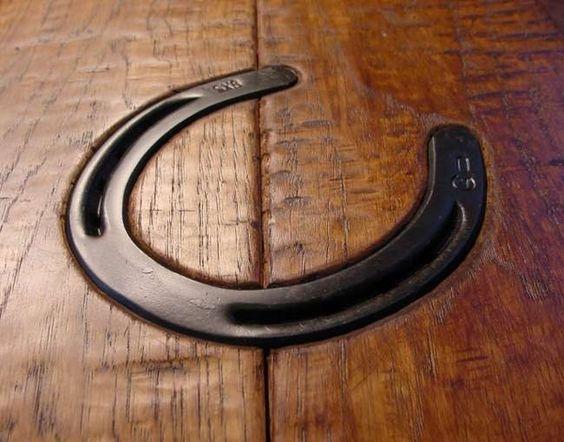 horseshoe inlaid into hardwood flooring
