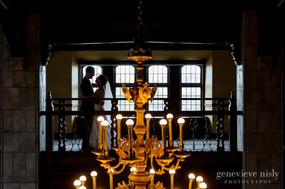Silhouette of bride and groom by the stunning chandelier at the Tudor Arms Hotel in Cleveland, Copyright Genevieve Nisly Photography, Summer, Ohio