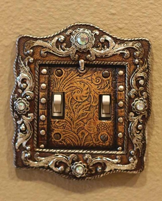 This Old West Vintage Brown Engraved Double Light Switch