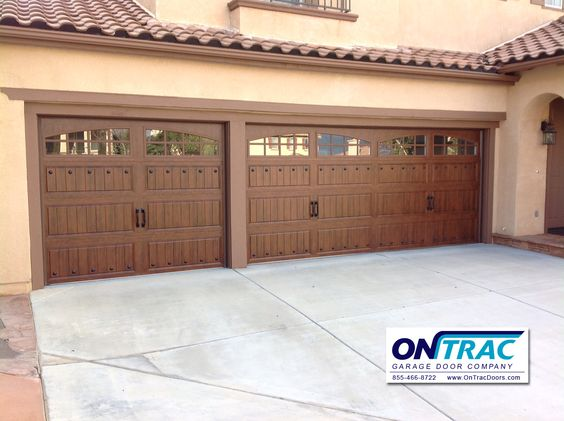 Steel walnut wood grain garage door with decorative for Home hardware garages