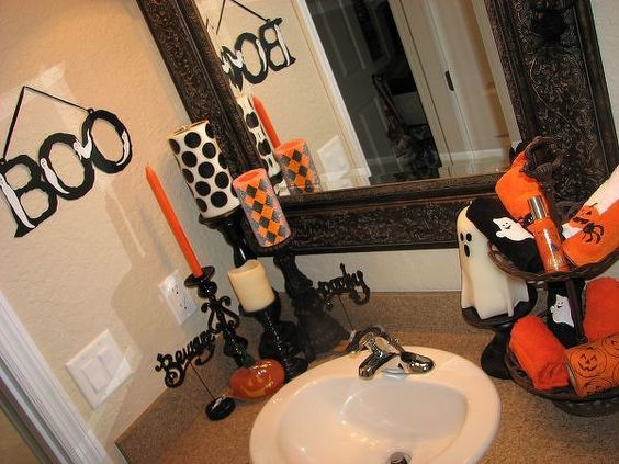 Halloween bathroom 3 - could get cheap candle holders at goodwill/marshals and paint them black.