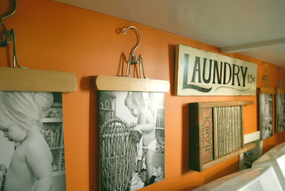 Hang pictures in the laundry room from skirt hangers. CUTE idea!