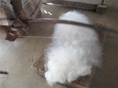 Photos of several steps in hand-preparing cotton for spinning - including bowing and rolling punis.