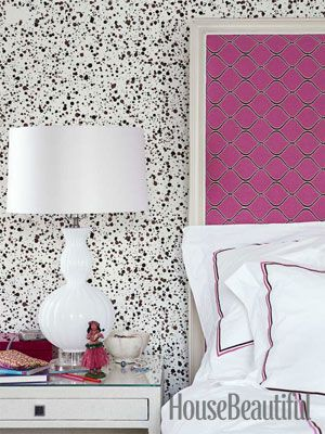 Covered headboard and splatter paint wallpaper. Design: Pat Healing. Photo: Maura McEvoy. housebeautiful.com #bedroom #wallpaper #headboard #pink #splatter so into splatter paint paper!