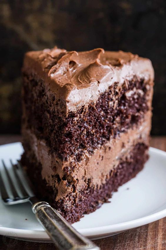 A decadent and moist Chocolate Cake recipe with the easiest whipped Chocolate Frosting. Homemade chocolate cake makes for a stunning birthday cake. #chocolatecake #chocolatecakerecipe #moistchocolatecake #birthdaycake #chocolatefrosting #cake #dessert #natashaskitchen