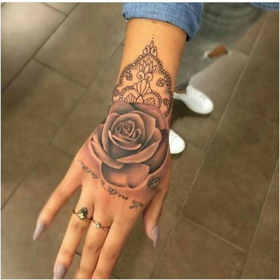 Rose Tattoo On Hand For Women Tattoos Hand Tattoos Rose Hand Tattoo