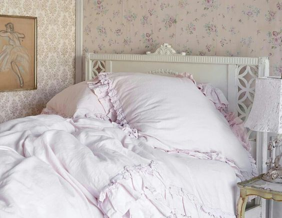 Shabby Chic Decor Inspiration in this pink romantic bedroom with floral wallpaper and vintage style. #shabbychic #bedroomdecor #rachelashwell #romanticdecor