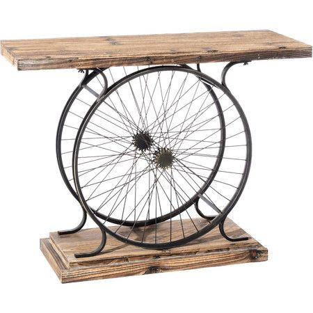 Channelling industrial style influences, this distressed-effect console table features a wheel design for an impressive hallway display.  ...