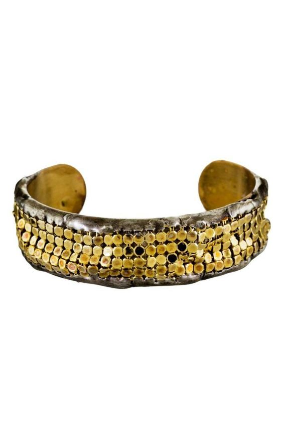 """This Mikal Winn cuff bracelet is bold and edgy. A strip of gold-plated brass mesh by iconic Whiting & Davis fits loosely across the top of the brass cuff bracelet. A textured, molten frame of sterling silver holds the mesh in place while also letting it move to create a fluid, slinky affect    Measures: Interior dimensions : 2 1/4"""" x 1 1/2"""" , total height : 1 1/8"""" Slips over wrist   Gold Mesh Cuff by Mikal Winn. Accessories - Jewelry - Bracelets New York City"""
