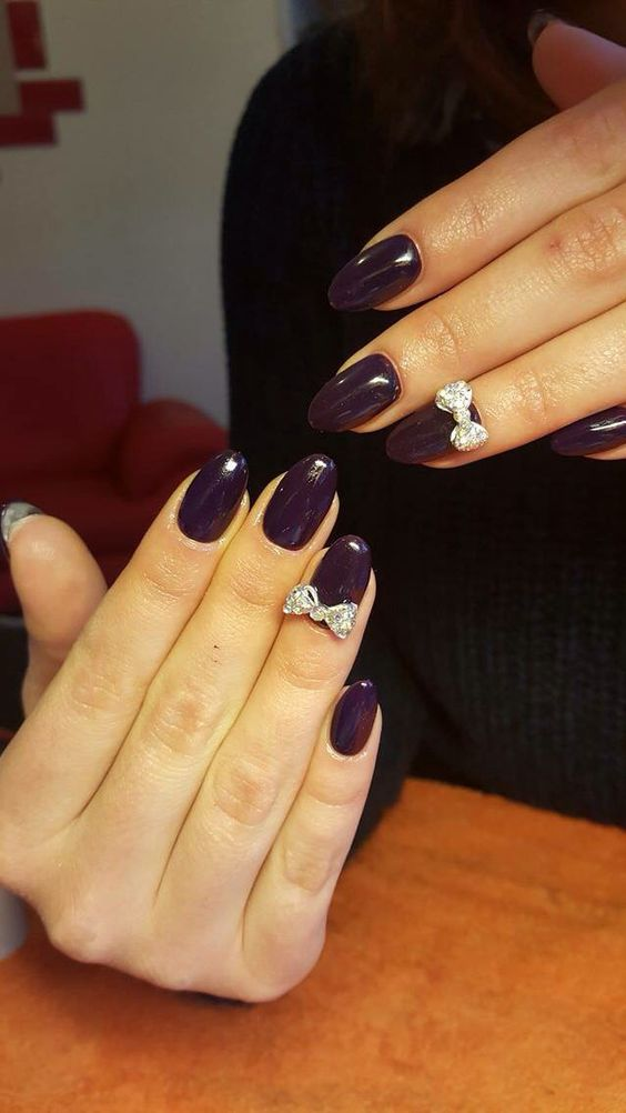 Purple almond nails with a bow. Nice and simple :) @sandruteee3