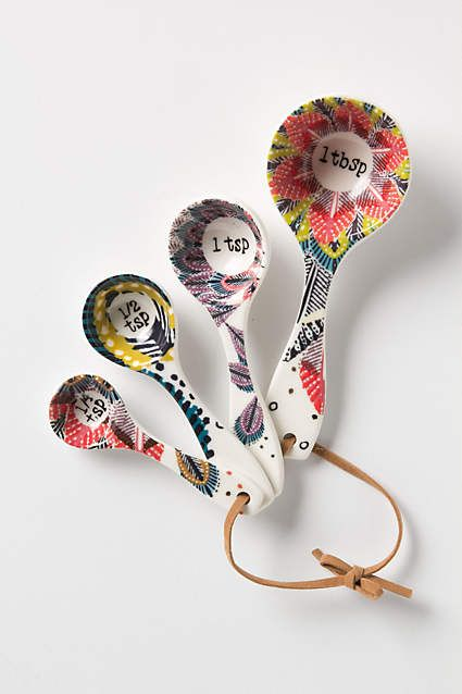 Pop-Print Measuring Spoons. Stoneware scoops, illustrated with petals, plumes and polka-dots.