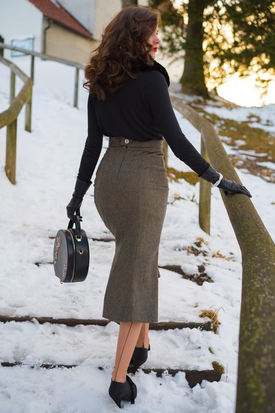 RetroCat wearing a 1930s inspired skirt, seamed stockings, vintage gloves, and a retro handbag.