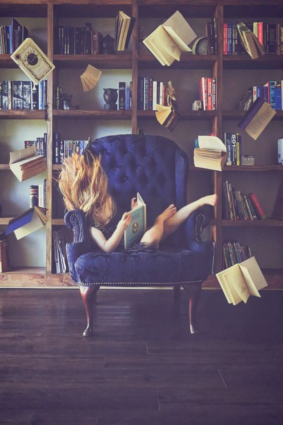 magic levitation photography reading books surreal eerie flying little girl library book wall