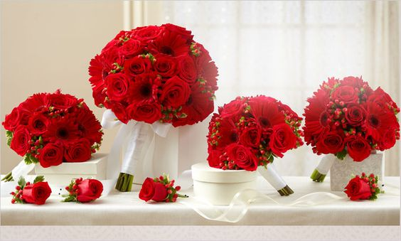 These bright red bouquets add a flash of brilliant color to any bridal party!