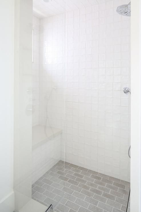 A Seamless Glass Shower Boasts Gray Brick Floor Tiles Complementing White Grid Surround Tiles And A Gray Brick Tile Shower Brick Bathroom Brick Tiles Bathroom