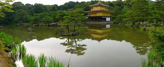 """Kinkaku-ji also known as Rokuon-Ji (Deer Garden Temple).  A Zen Buddhist temple in Kyoto, Japan.  My visit to this temple was amazing.  I took a stroll around the pond which reflects the temple.  I don't recall seeing deer at this temple unlike the temples in Nara.  I was told that the gold leafs were done by one person in order for each piece to be placed with the same """"touch"""".  During the festival's you can purchase sake with gold flakes!"""