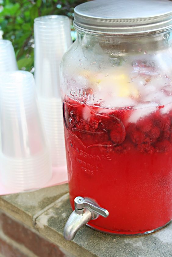 Raspberry Lemonade ~ 1 liter Sprite, 1 (12 fl oz), frozen Raspberry Lemonade (I used Minute Maid), 3 cans of Water, 1 1/2 bags of Frozen Raspberries, 3 Lemons (sliced thin)