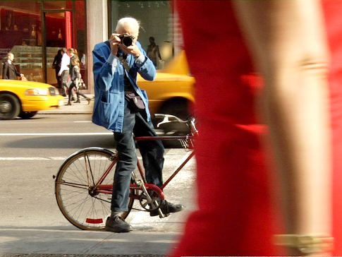 Bill Cunningham...Looking at him taken a pic while on bike reminds me of myself.  Awesome!!