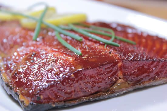 This maple glazed smoked salmon recipe is easy to make and goes into great detail showing you how to brine, dry, smoke and glaze the salmon to perfection.