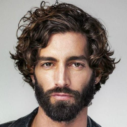 The Curly Shoulder Length Hairstyle Will Fit Pretty Much Any Man With Wavy Or Curly Hair Fro In 2020 Curly Hair Men Curly Hair Styles Naturally Men S Curly Hairstyles