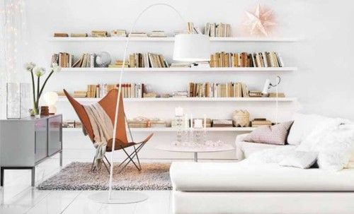 What I wouldn't give to be curled up on THAT couch reading THOSE books.