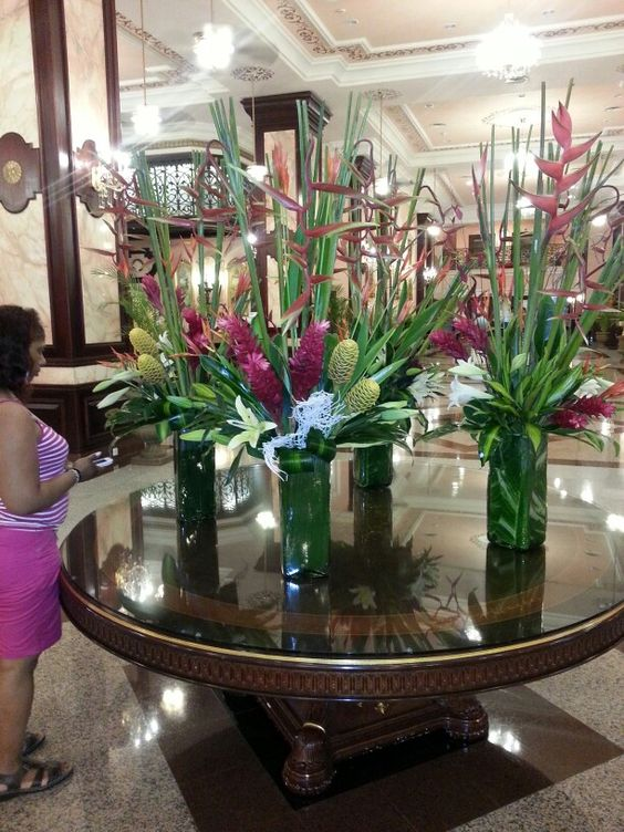 Floral arrangements foyers and resorts on pinterest for Foyer flower arrangement