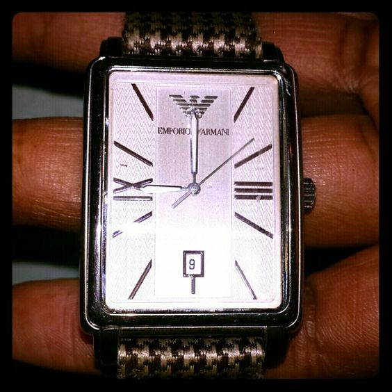 Emporio Armani MENS watch Previously loved mens Armani watch needs a battery. Can purchase a battery at a mall for like $10 Emporio Armani Jewelry