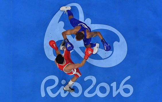 Enrico Lacruz of the Netherlands (blue) fights Otgondalai Dorjnyambuu of Mongolia (red) in their Mens Lightweight 60kg bout on Day 4 of the Rio 2016 Olympic Games at the Riocentro - Pavilion 6 on Aug. 9, 2016. | Best Photos From The Rio Olympics