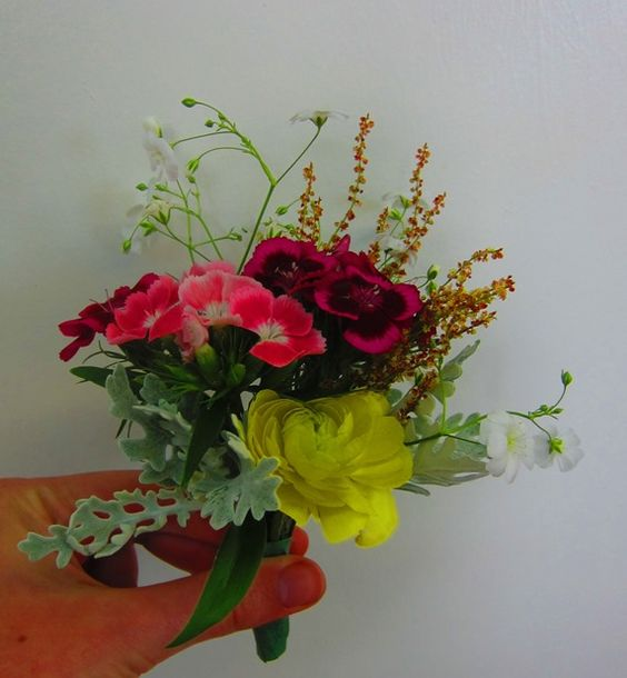 Corsage from McAdams Farm for a spring wedding.  Pinks, reds, and yellows.