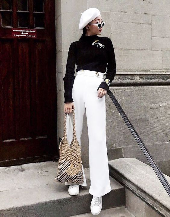 Pants with buttons and brooch/brangle...spring street style outfit ideas 2018: monochrome outfit with a woven bag, beret, brooch and cat-eye sunglasses
