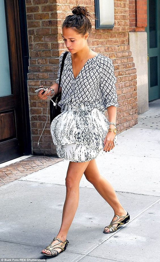 Print clash: The actress put on a delightfully leggy display in her mismatched printed min...