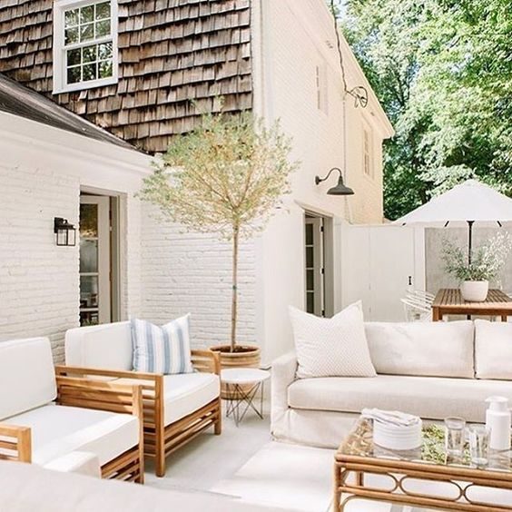 Beautiful outdoor patio space with a modern coastal vibe perfect for summer entertaining